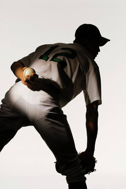 Three Quarter Length Art Print featuring the photograph Silhouette Of Baseball Pitcher Holding by Pm Images