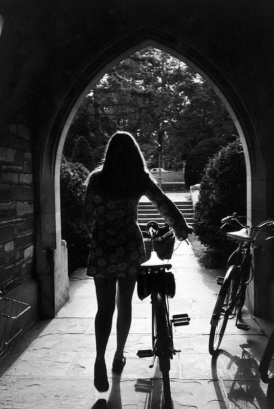 Arch Art Print featuring the photograph Silhouette Of College Co-ed Walking Her by Alfred Eisenstaedt