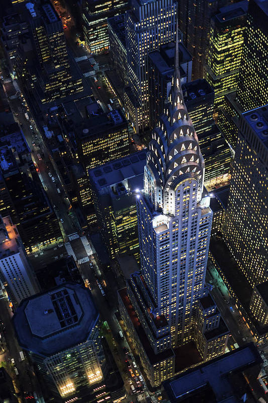 Downtown District Art Print featuring the photograph The Chrysler Building And Manhattan by Berthold Trenkel