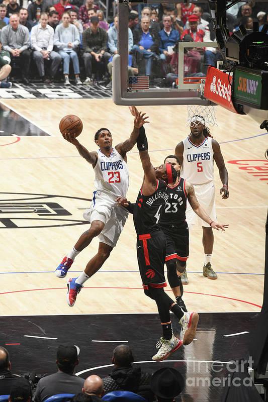 Nba Pro Basketball Art Print featuring the photograph Toronto Raptors V Los Angeles Clippers by Adam Pantozzi