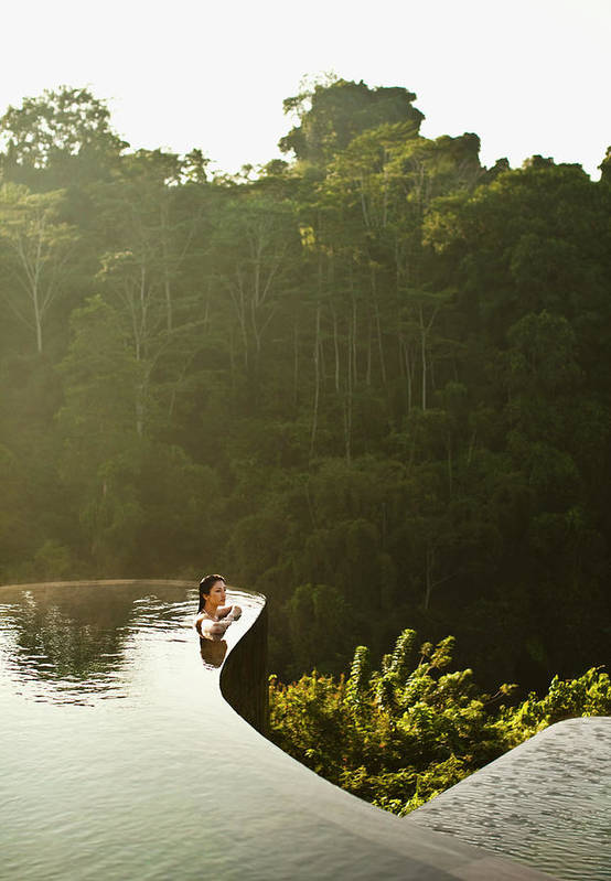 Tropical Rainforest Art Print featuring the photograph Woman In Infinity Pool At Sunrise. Bali by Matthew Wakem