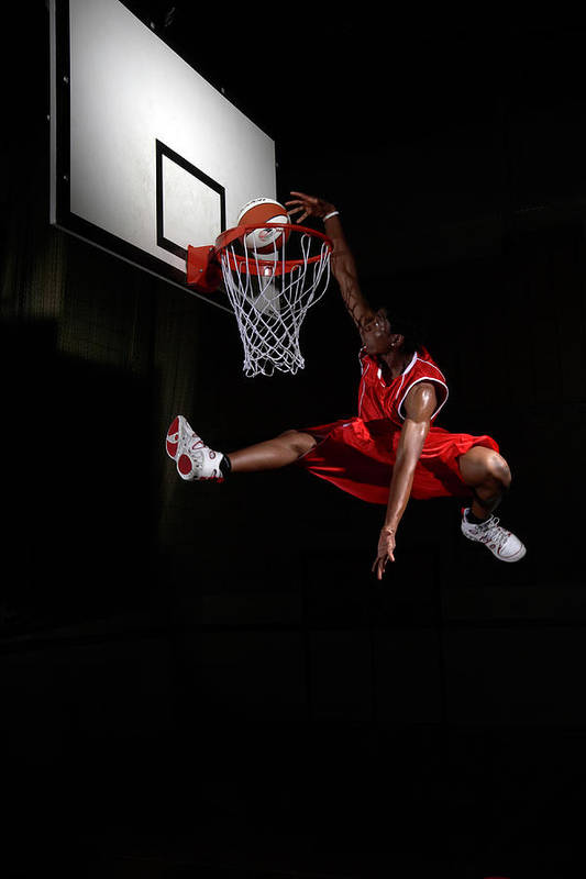 Human Arm Art Print featuring the photograph Young Man Making A Fancy Dunk by Compassionate Eye Foundation/steve Coleman/ojo Images Ltd