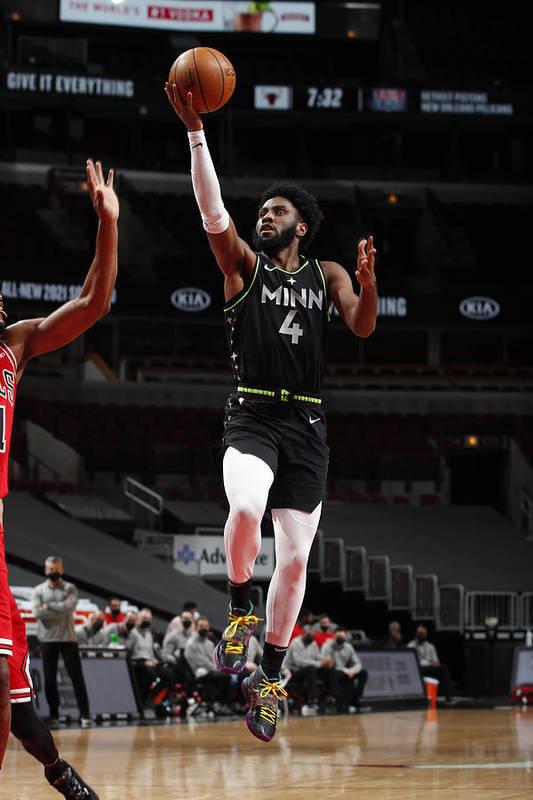 Nba Pro Basketball Art Print featuring the photograph Minnesota Timberwolves v Chicago Bulls by Jeff Haynes