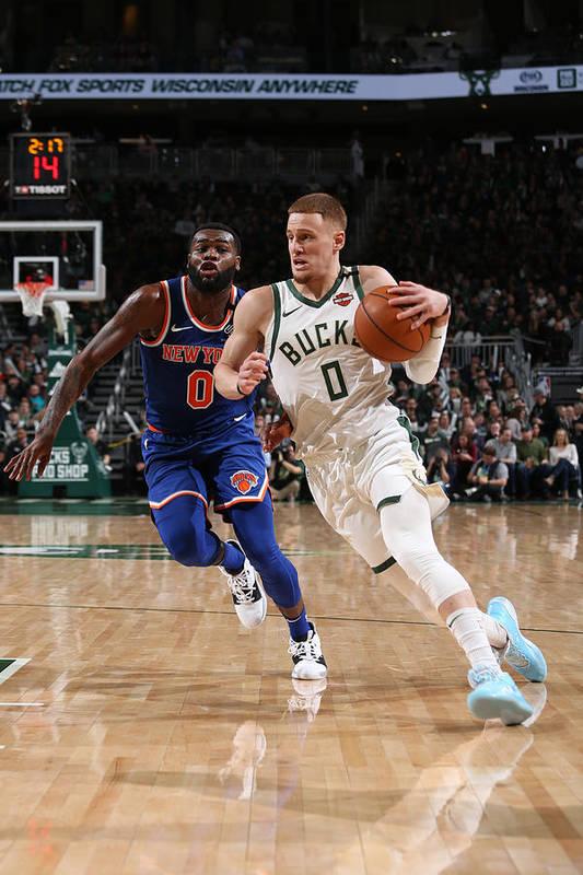 Nba Pro Basketball Art Print featuring the photograph New York Knicks v Milwaukee Bucks by Gary Dineen