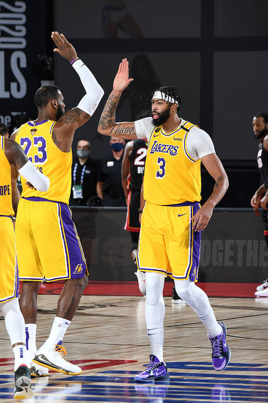 Playoffs Art Print featuring the photograph Anthony Davis and Lebron James by Andrew D. Bernstein