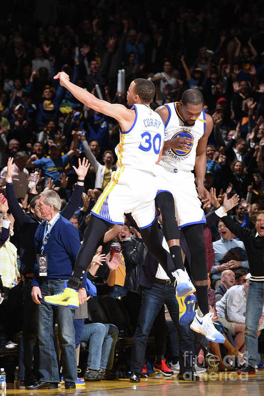 Nba Pro Basketball Art Print featuring the photograph Stephen Curry and Kevin Durant by Andrew D. Bernstein