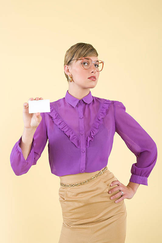 People Art Print featuring the photograph A woman holding a business card by Image Source