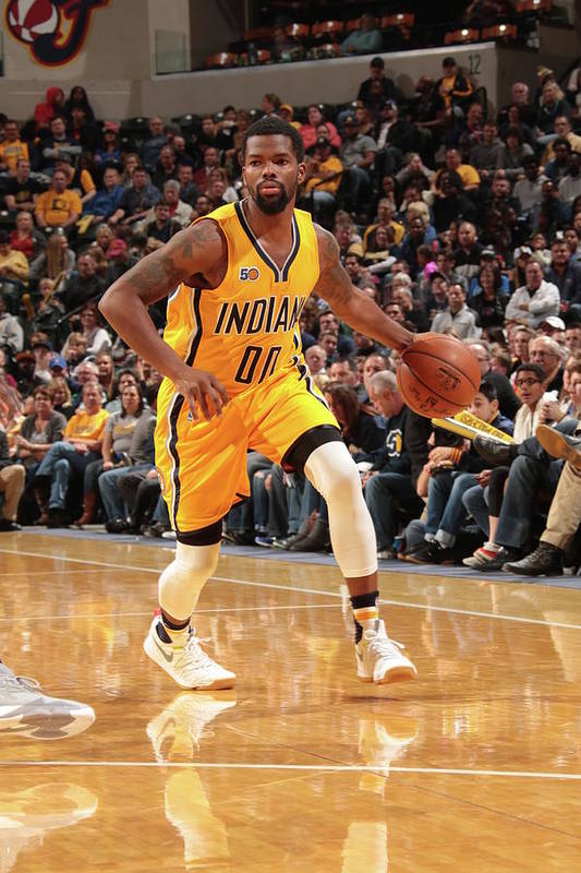 Nba Pro Basketball Art Print featuring the photograph Aaron Brooks by Ron Hoskins