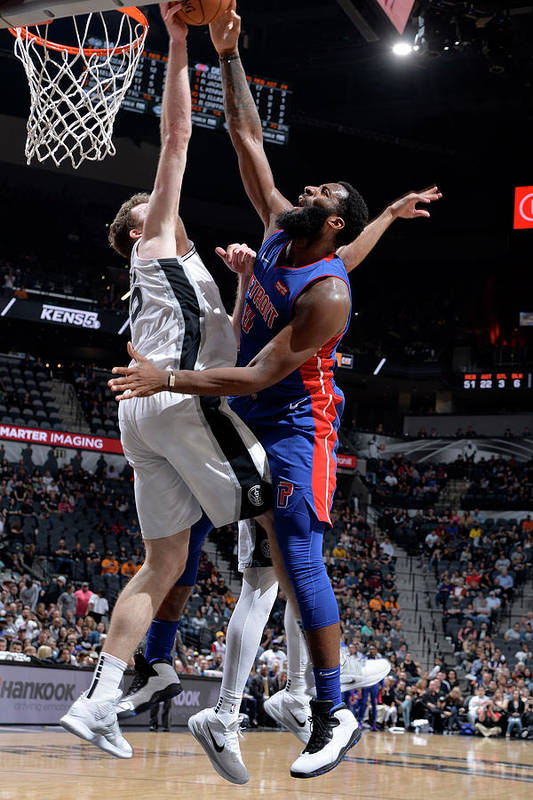 Nba Pro Basketball Art Print featuring the photograph Andre Drummond and Jakob Poeltl by Mark Sobhani