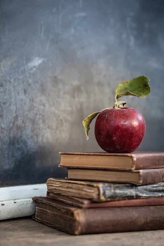 Education Art Print featuring the photograph Apples On Stack Of Books by Leslie Banks / EyeEm