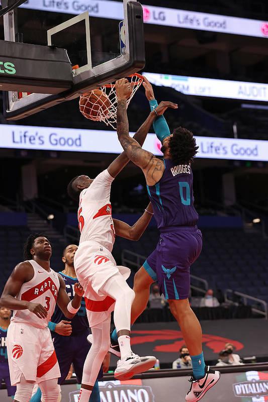 Nba Pro Basketball Art Print featuring the photograph Charlotte Hornets v Toronto Raptors by NBA Photos