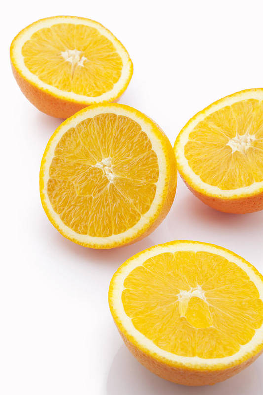 White Background Art Print featuring the photograph Close-up of sliced oranges by Ravi Ranjan