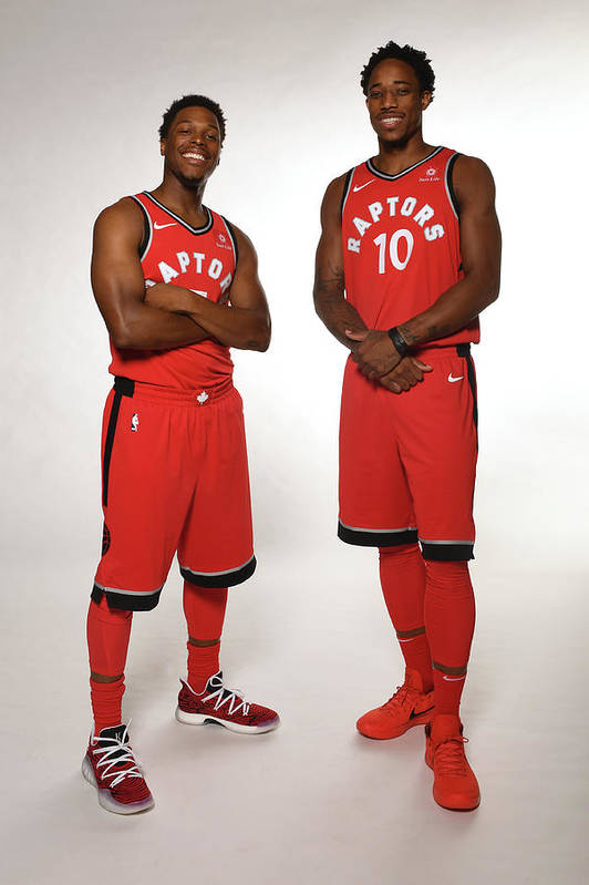 Media Day Art Print featuring the photograph Demar Derozan and Kyle Lowry by Ron Turenne