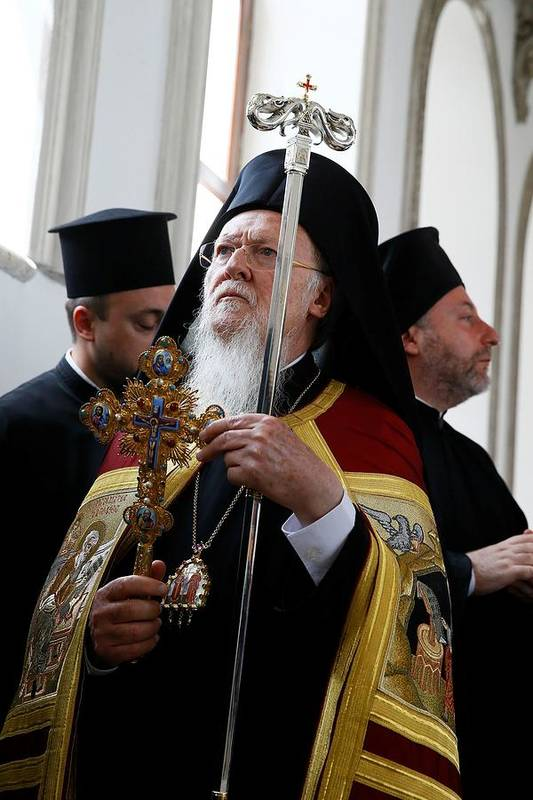 Vertical Art Print featuring the photograph Fener-Greek Patriarch Bartholomew presides mass in Izmir by Anadolu Agency
