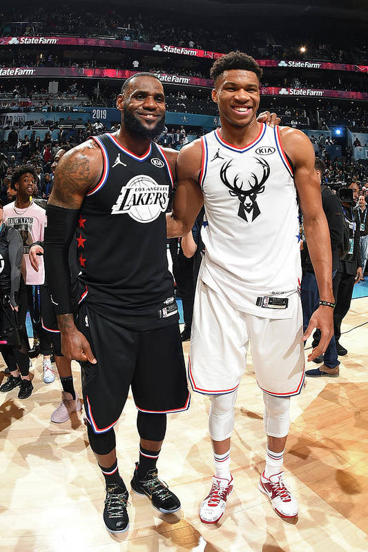Nba Pro Basketball Art Print featuring the photograph Giannis Antetokounmpo and Lebron James by Andrew D. Bernstein
