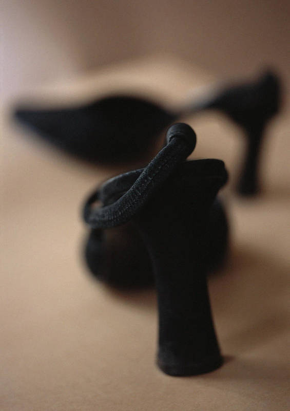 Black Color Art Print featuring the photograph High-heeled shoes, close-up, blurred by Michele Constantini