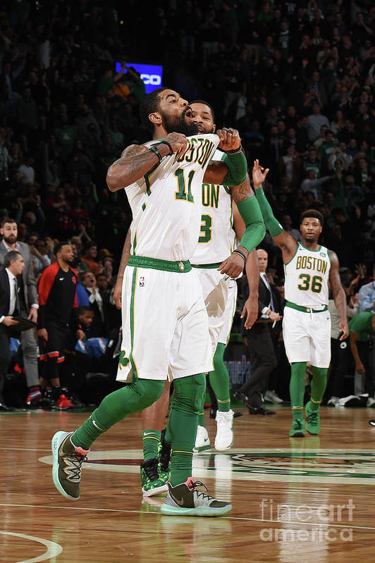 Nba Pro Basketball Art Print featuring the photograph Kyrie Irving and Marcus Morris by Brian Babineau