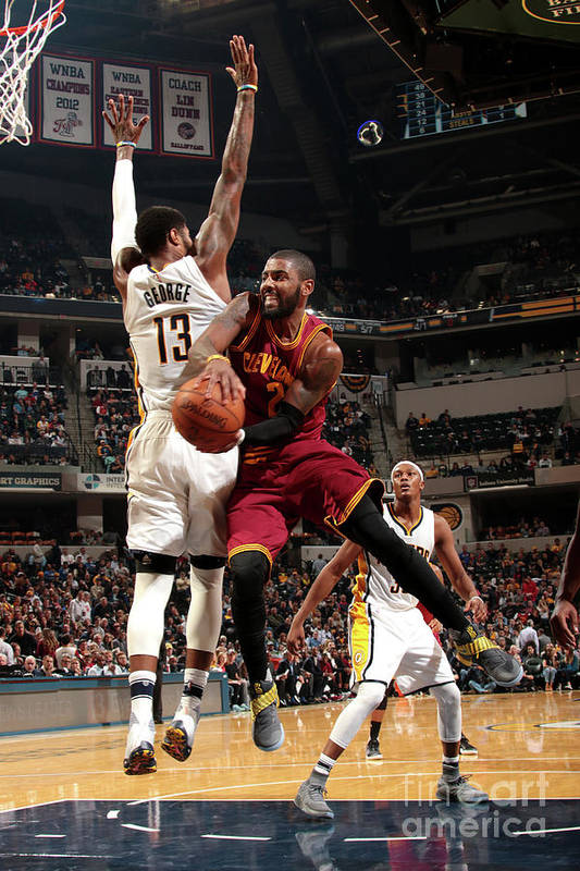 Nba Pro Basketball Art Print featuring the photograph Kyrie Irving by Ron Hoskins