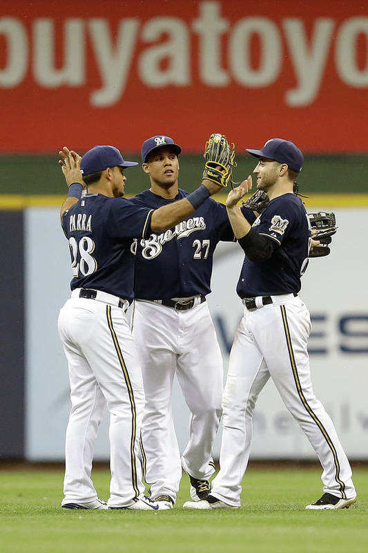 People Art Print featuring the photograph Ryan Braun, Gerardo Parra, and Carlos Gomez by Mike Mcginnis