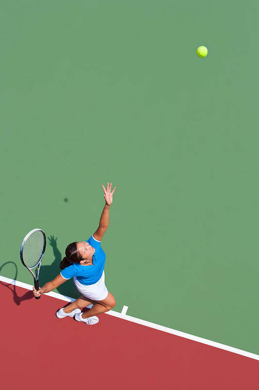Asian And Indian Ethnicities Art Print featuring the photograph Young tennis player serving by Nycshooter