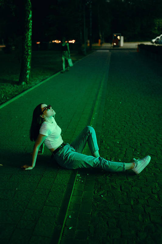 Cool Attitude Art Print featuring the photograph Young woman in sunglasses in neon lighting by Masha Raymers