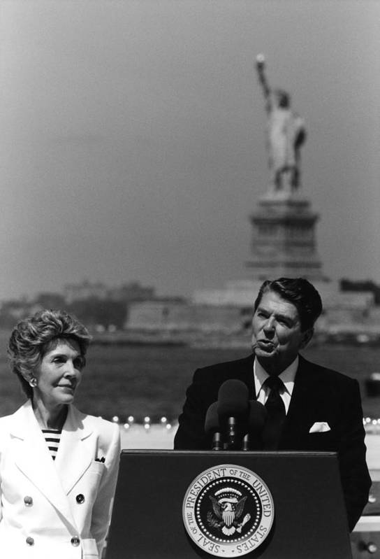 Ronald Reagan Art Print featuring the photograph Reagan Speaking Before The Statue Of Liberty by War Is Hell Store