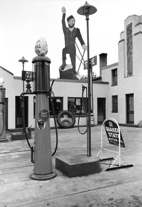 1930s Candid Art Print featuring the photograph Paul Bunyan Atop Gas Station, Bemidji by Everett