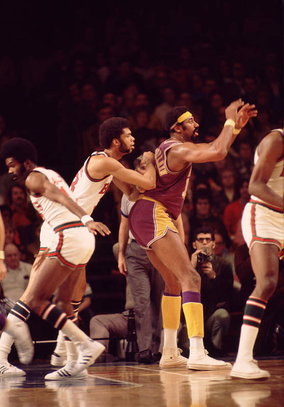 Marvin Newman Art Print featuring the photograph Kareem Abdul Jabbar Guards Wilt Chamberlain by Retro Images Archive