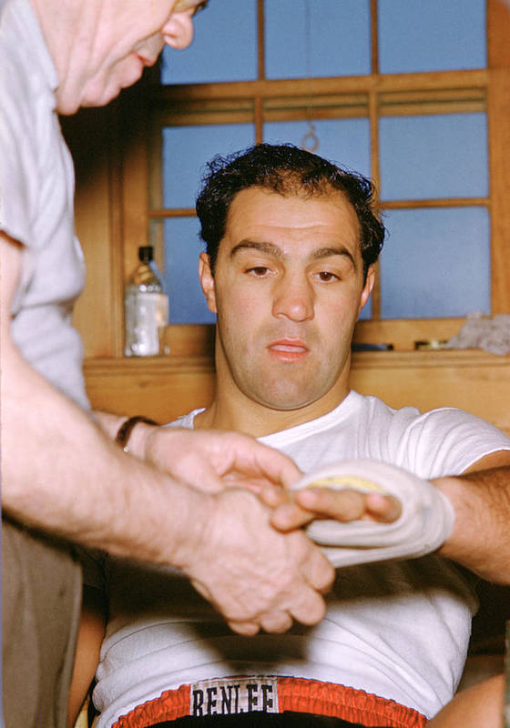 Marvin Newman Art Print featuring the photograph Rocky Marciano Getting Taped Up by Retro Images Archive
