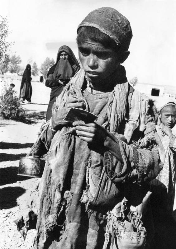 History Art Print featuring the photograph Afghan Youngster In A Unicef Feeding by Everett