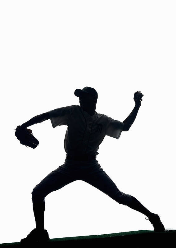 25-29 Years Art Print featuring the photograph Silhouette Of Baseball Pitcher About To Pitch by PM Images