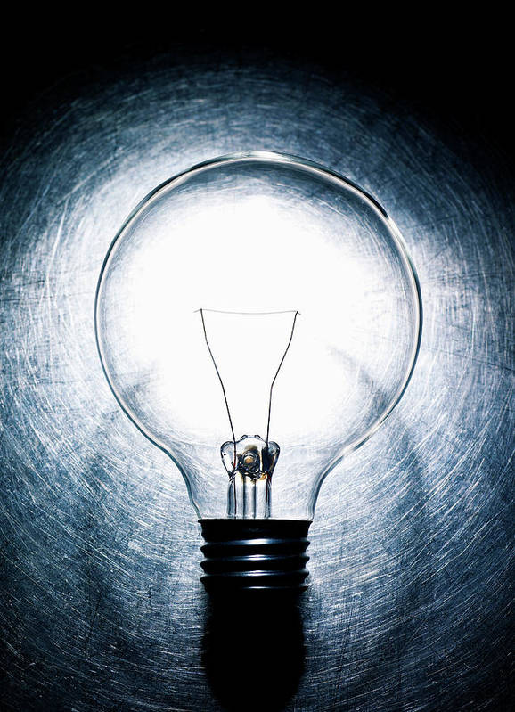 Vertical Art Print featuring the photograph Light Bulb On Stainless Steel Background. by Ballyscanlon