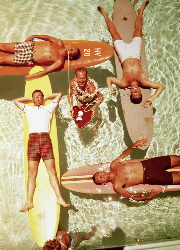 People Art Print featuring the photograph Men On Surfboards In Pool Sipping Drinks by Tom Kelley Archive