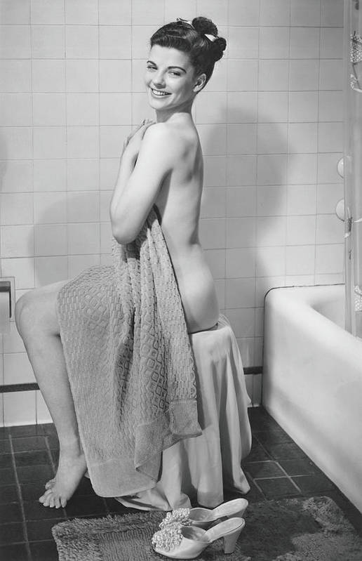 Looking Over Shoulder Art Print featuring the photograph Woman Sitting In Bathroom, Covering by George Marks