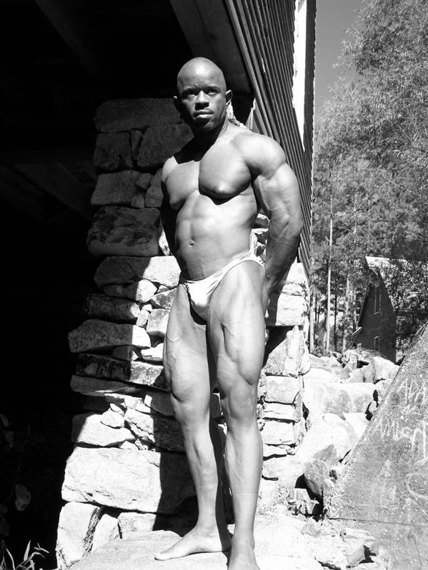 Sepia Photography Print featuring the photograph The Bodybuilder by Jake Hartz