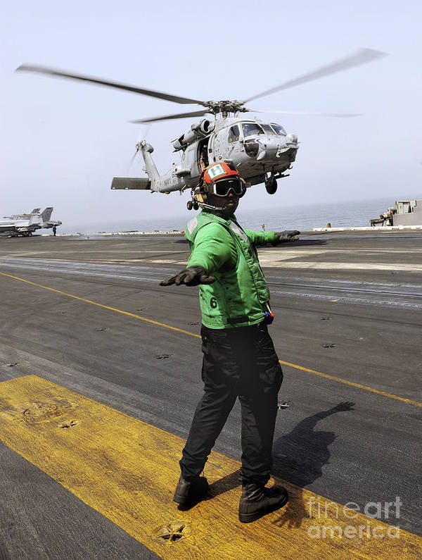 Uss Harry S Truman Art Print featuring the photograph Airman Checks The Takeoff Path by Stocktrek Images
