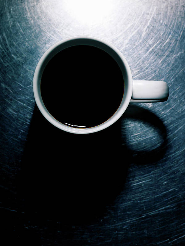Vertical Art Print featuring the photograph Coffee Cup On Stainless Steel. by Ballyscanlon