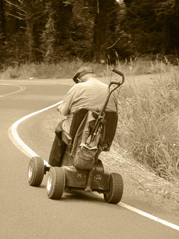 Old Man On Scooter Art Print featuring the photograph I'll Get There by Kym Backland