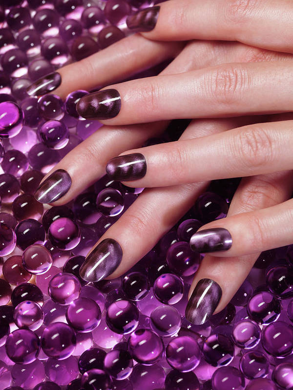 Manicure Art Print featuring the photograph Closeup Of Woman Hands With Purple Nail Polish by Maxim Images Prints