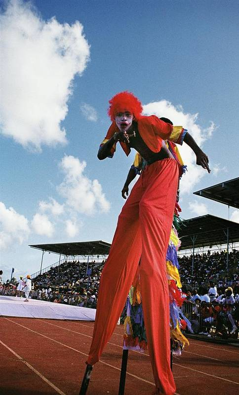 Barbados West-indies Caribbean Crop-over Annual Festival Carnival Stilt-man Stilt-walker National Stadium Colonial Practice Historical Culture Costume Art Print featuring the photograph Stiltman by Ronald Griffith