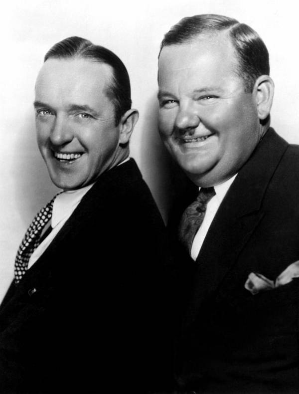 1920s Portraits Print featuring the photograph Stan Laurel, Oliver Hardy Laurel & Hardy by Everett