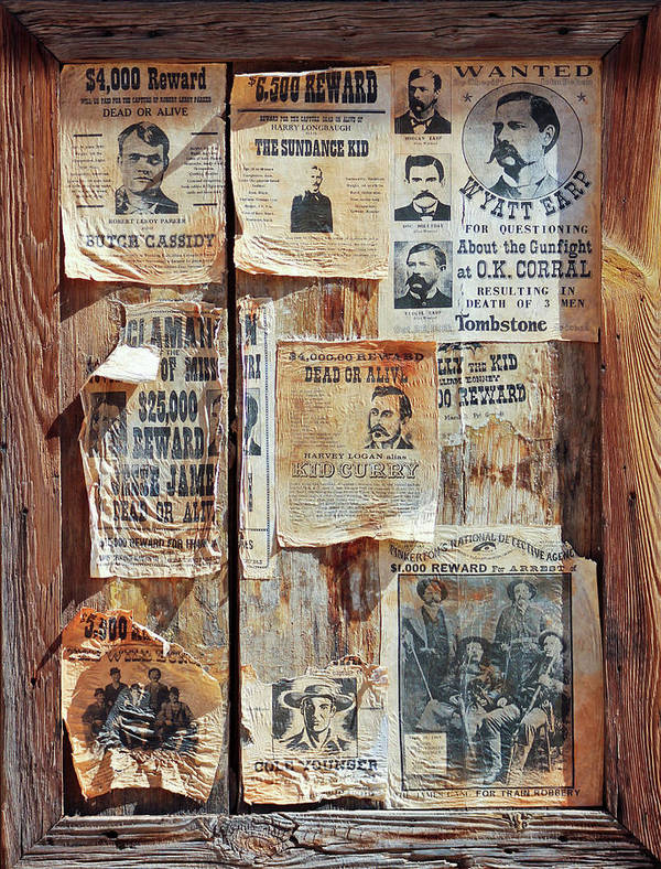 History Art Print featuring the photograph A Wooden Frame Full Of Wanted Posters by Derrick Neill