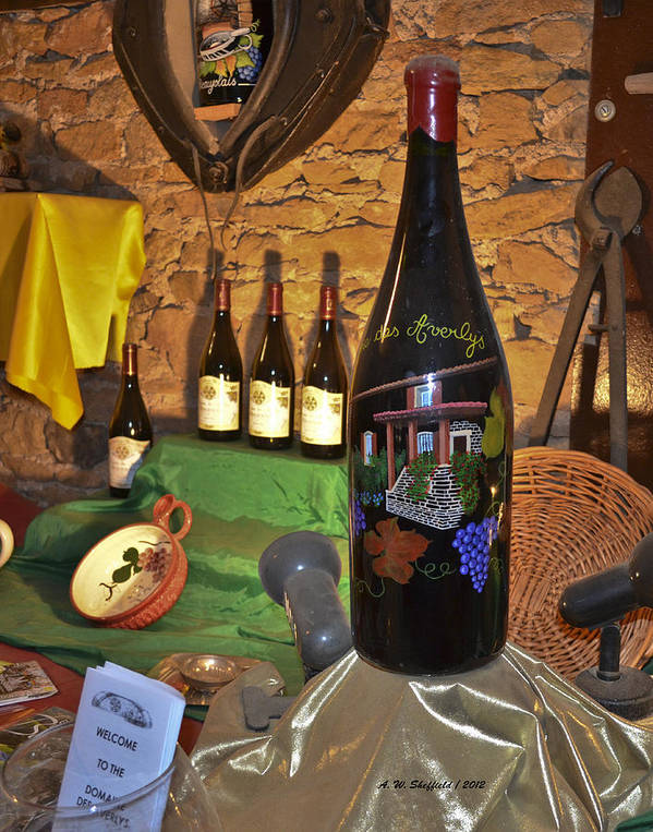 Wine Art Print featuring the photograph Wine Bottle On Display by Allen Sheffield
