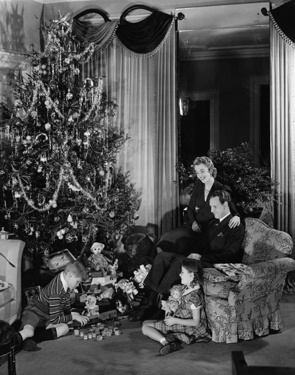 6-7 Years Art Print featuring the photograph Family With Two Children (6-9) Sitting At Christmas Tree, (b&w) by George Marks