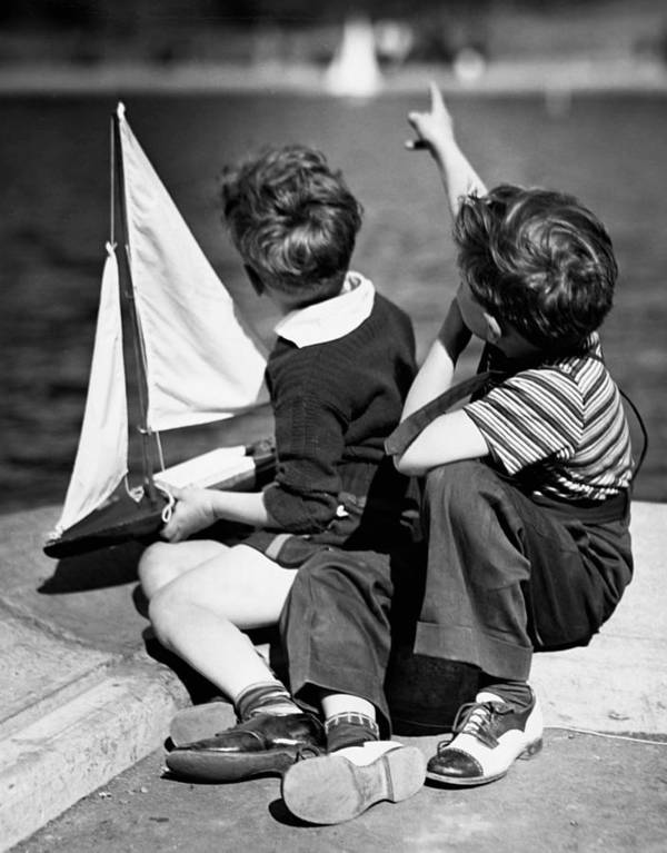 Child Art Print featuring the photograph Two Boys Playing W/sailboats by George Marks