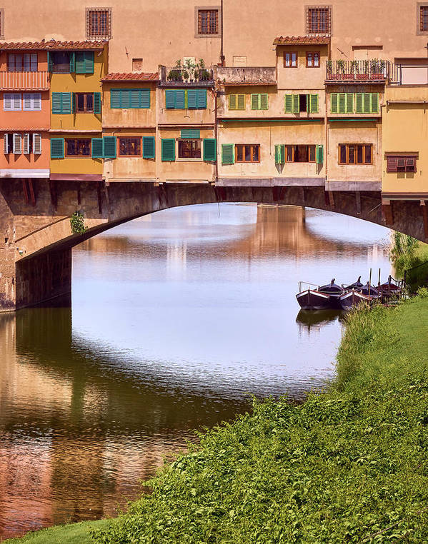 Boats parked below Ponte Vecchio in Florence