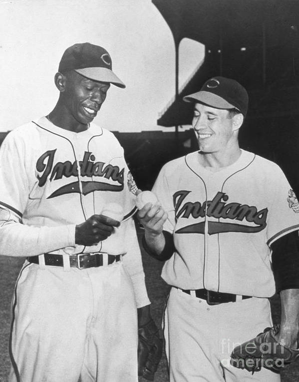 American League Baseball Art Print featuring the photograph Satchel Paige Bob Feller Comparing by Transcendental Graphics