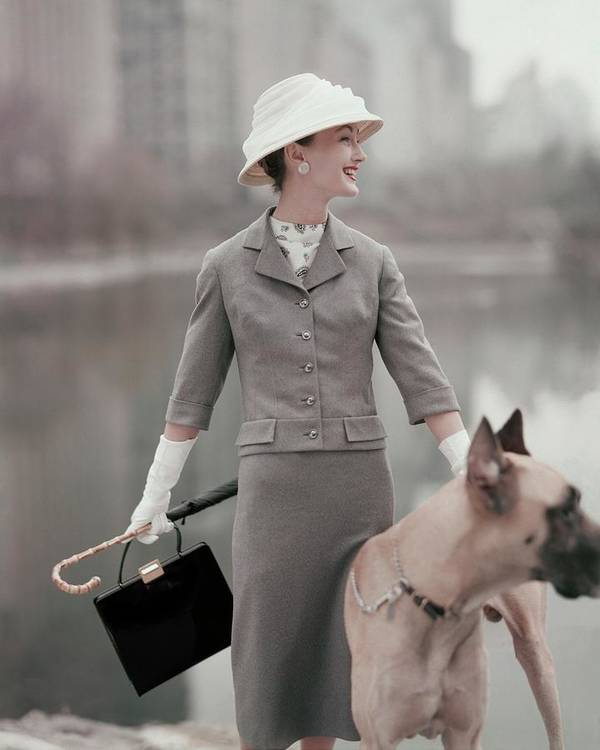Fashion Art Print featuring the photograph A Model Wearing A Gray Suit With A Dog by Karen Radkai