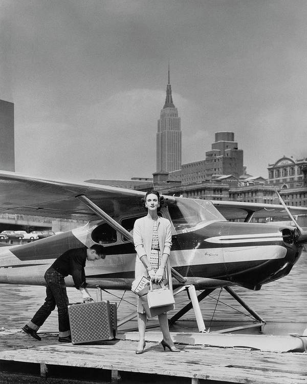 Two People Art Print featuring the photograph Lucille Cahart With Small Plane In Nyc by John Rawlings