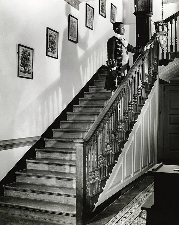 Antique Art Print featuring the photograph Man Dressed As Colonial Butler On The Stair by George Karger